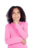 Pensive african little girl sitting on the floor Stock Image