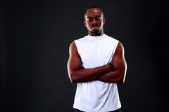 Pensive african man with arms folded Stock Images
