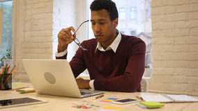 Pensive Afro-American Man Brainstorming at Workplace Stock Images