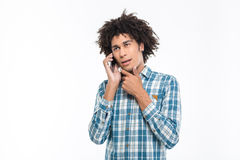 Pensive afro american man talking on the phone Stock Images