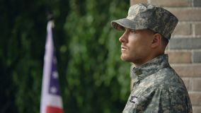 Pensive american military man looking at rain, suffering depression and ptsd. Stock footage stock video footage