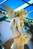 Pensive angel sitting Stock Images