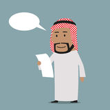 Pensive arab businessman reading contract Royalty Free Stock Image