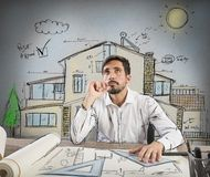 Pensive architect. Architect thinks how to design a house Stock Image