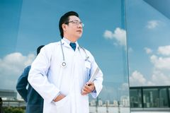 Pensive Asian doctor Stock Image