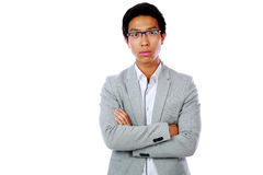 Pensive asian man with arms folded Stock Photography
