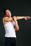 Pensive asian man stretching hands Royalty Free Stock Photos