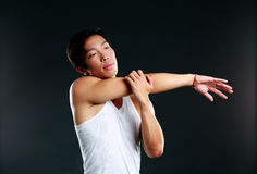 Pensive asian man stretching hands Royalty Free Stock Photo