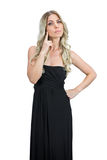 Pensive attractive blonde with black cocktail dress posing Stock Photo