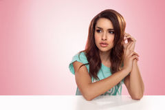 Pensive woman staring into space Royalty Free Stock Image