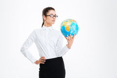 Pensive attractive young business woman holding earth globe Stock Images