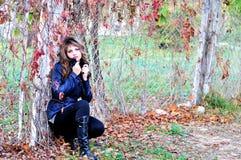 Pensive autumn teen girl Stock Images