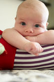 Pensive baby lying on a crawling roll Royalty Free Stock Photos