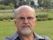 Pensive bald mature man. With a beard, close-up outdoors Stock Photography