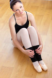 Pensive ballerina sitting on the floor Royalty Free Stock Image
