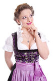 Pensive bavarian woman - woman isolated on white background Stock Image