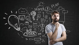 Pensive bearded businessman near startup idea sketch on chalkboa Royalty Free Stock Images