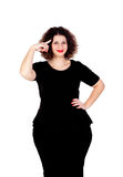 Pensive beautiful curvy girl with black dress Stock Image