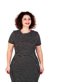 Pensive beautiful curvy girl with striped dress Royalty Free Stock Photos