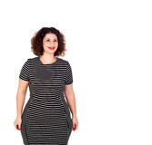 Pensive beautiful curvy girl with striped dress Royalty Free Stock Image