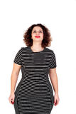 Pensive beautiful curvy girl with striped dress Royalty Free Stock Photo