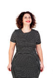 Pensive beautiful curvy girl with striped dress Stock Image