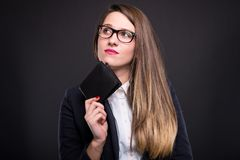 Pensive beautiful girl with leather wallet Stock Photography
