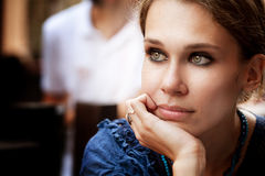 Pensive beautiful woman in the city. Portrait of pensive beautiful woman in the city royalty free stock photos