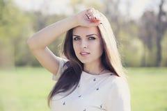 Pensive beautiful woman Stock Image