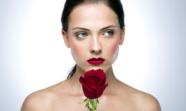 Pensive beautiful woman with rose Royalty Free Stock Photos