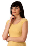 Pensive beautiful young woman looking into copyspace Royalty Free Stock Image