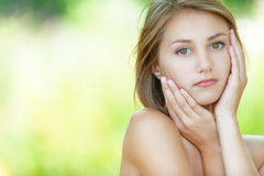 Pensive beautiful young woman Royalty Free Stock Photos