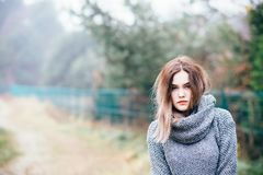 Pensive beautiful young woman in woolen sweater. Autumn Royalty Free Stock Photos