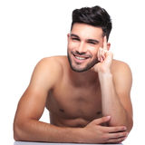 Pensive beauty naked man is laughing. Smiling and pensive beauty naked man is laughing on a white background Royalty Free Stock Photography