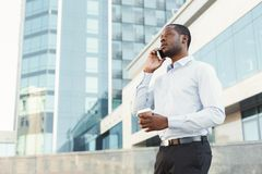 Portrait of a confident young black businessman talking on cell phone Stock Images