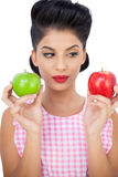 Pensive black hair model holding apples Royalty Free Stock Photo