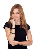 Pensive blond woman with black shirt Stock Image