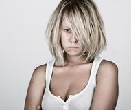 Pensive Blonde Female in White Vest Royalty Free Stock Images