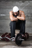 Pensive bodybuilder. Portrait of pensive bodybuilder looking down Stock Photos