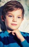 Pensive boy. Beautiful pensive boy with blue eyes Stock Photo
