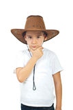 Pensive boy in cowboy hat. Pensive serious boy wearing cowboy hat and holding hand to chin isolated on white background stock photos
