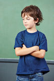 Pensive boy in elementary school Stock Image