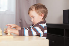 Pensive boy playing chess Royalty Free Stock Image