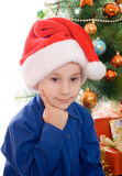 Pensive boy in santa hat Royalty Free Stock Photography