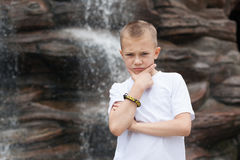 Pensive boy waterfall Royalty Free Stock Images