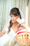 Pensive bride looking at camera Royalty Free Stock Images