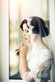 Pensive brunette bride Stock Images