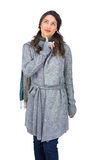 Pensive brunette wearing winter clothes posing Royalty Free Stock Images