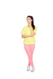 Pensive brunette woman with sport clothing Royalty Free Stock Photography