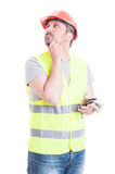 Pensive builder searching for solution at work Stock Photography